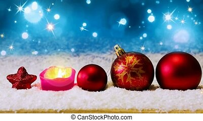 Red christmas balls and Advent candle. - Red christmas balls...
