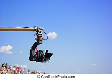 Professional TV camera on the crane on outdoor concerts