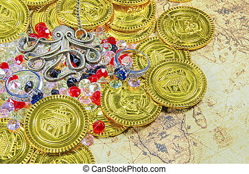 octopus necklace and golden pirate coins on a old world map