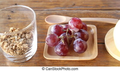 Homemade granola with yogurt and fruit ingredient, stock...