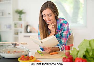 Young Woman Cooking - Beautiful young woman cooking healthy...