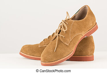 Tan suede lace up shoes close up - Close up of khaki brown...