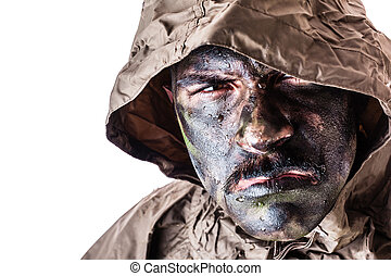 Elite Warrior - a soldier wearing a poncho or raincoat and...