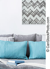 Decorative turquoise and grey cushions - Photo of decorative...