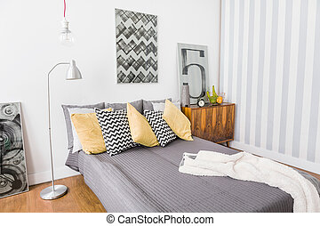 Matrimonial bed with grey bedding - Image of matrimonial bed...