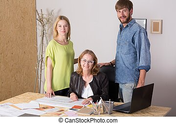 Three people working together - Picture of three people...