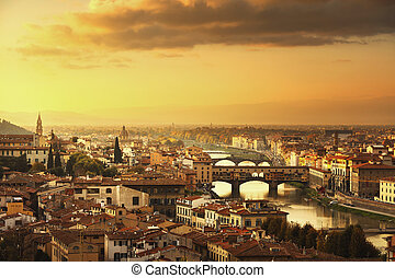 Florence or Firenze sunset Ponte Vecchio bridge panoramic view.Tuscany, Italy