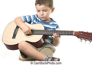 Playing guitar - A sweet boy playing guitar isolated on...