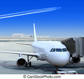 white liner at the airport - big passenger airplane is...