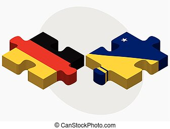 Germany and Tokelau Flags in puzzle isolated on white...