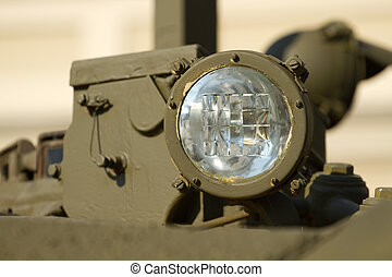 Headlight military tank - Headlight close-up on a military...