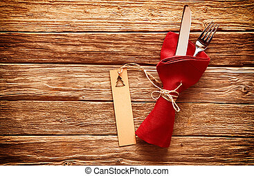 Rustic colorful red Christmas place setting with cutlery...