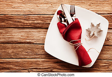 Cutlery in Red Napkin and Snowflake Cutter on Dish