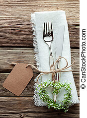 Heart Shaped Wreath and Wedding Cutlery on White Napkin -...