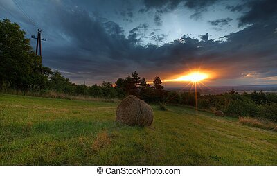 sunset over charming countryside field after the harvest...