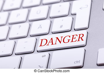 High end aluminium keyboard with DANGER word in red on it...