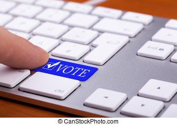 Finger pressing on vote blue button and symbol
