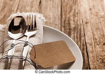 Rustic Christmas place setting with a knife and for on a...