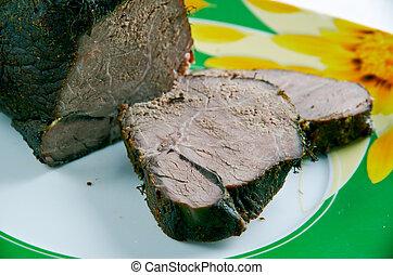 baked venison - Poronpaist - chopping freshly baked venison