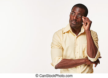 Young black african man thinking and reminiscing about...