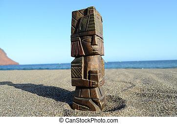 Ancient Maya Statue on the Sand Beach