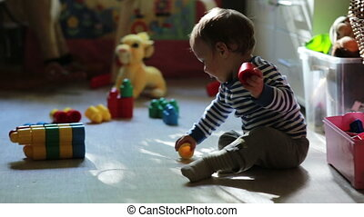 Little cute boy playing with toys in the room - Little cute...