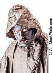 Raincoat soldier - a soldier wearing a poncho or raincoat...
