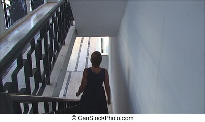 young woman walking down the stairs