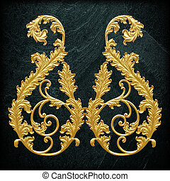 Ornament elements, vintage gold floral designs on black slate background or texture