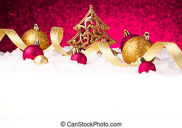 christmas fir tree decoration on red glitter background