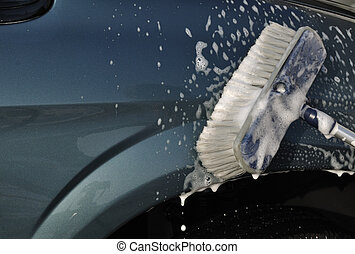 Washing Car with Scrub Brush, plenty of copy space
