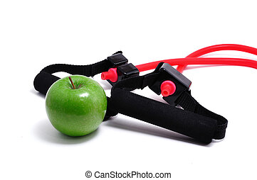Resistance Band and Green Apple isolated on a white...