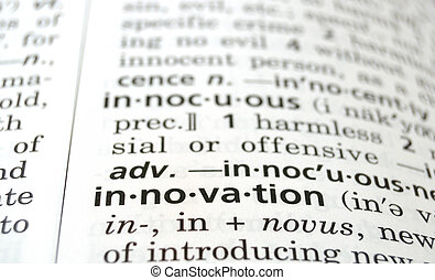 Innovation Defined - Closeup of the word innovation in a...