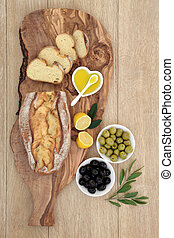 Olives and Bread Feast - Olives with fresh homemade bread on...