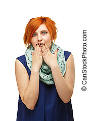 portrait of a funny red-haired girl emotionally gesticulating and waving his hands isolated on white background