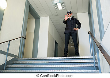 Security Guard Making Stop Gesture - Confident Male Security...