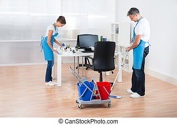Cleaners With Cleaning Equipments Cleaning The Office - Two...