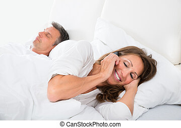 Woman Busy On Phone While Man Sleeping - Woman Talking On...