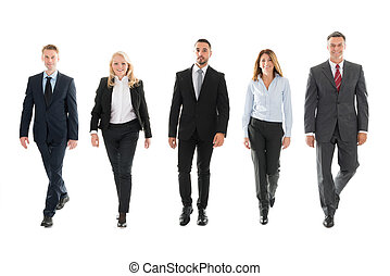Confident Business People Walking Against White Background -...