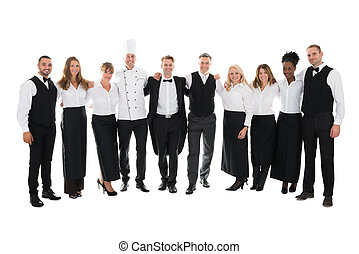 Confident Restaurant Staff Standing With Arms Around - Full...
