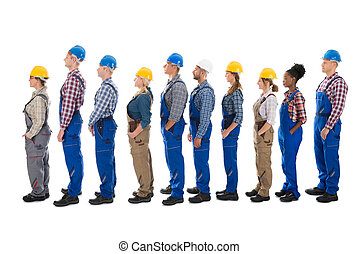 Side View Of Carpenters Standing In Line