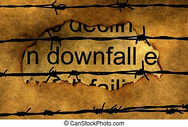 Downfall text on paper hole against barbwire