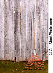 Rusty rake - Used old flexible fork rake propped against a...