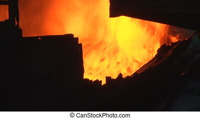 Pours burning coal fire - The process of working on the...