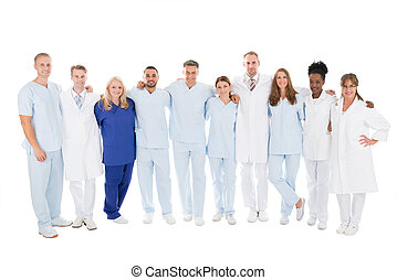 Confident Medical Team Standing With Arms Around - Full...