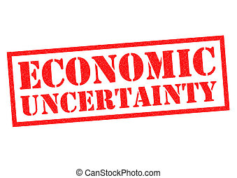 ECONOMIC UNCERTAINTY red Rubber Stamp over a white...