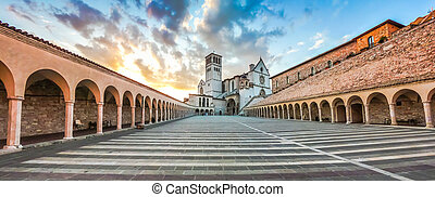 Basilica of St. Francis of Assisi at sunset, Assisi, Umbria,...