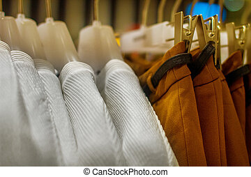 blouses and skirts hanging on a hanger in the storec - mage...