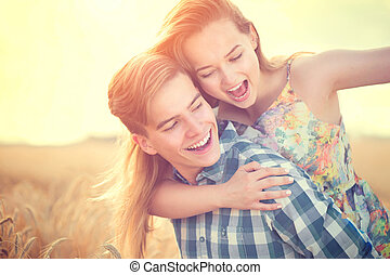Young couple having fun outdoors. Love concept