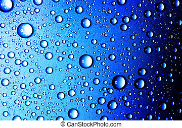Water drops closeup. Abstract blue background of waterdrops